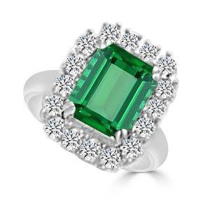Anillo de oro blanco modelo orla de diamantes y esmeralda